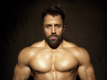 chest hair: An image of a handsome young muscular sports man Stock Photo