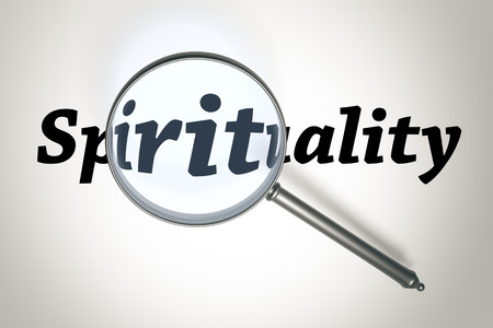 An image of a magnifying glass and the word Spirituality