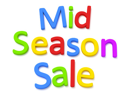 magnetic: Some colorful magnetic letters building the words mid season sale Stock Photo