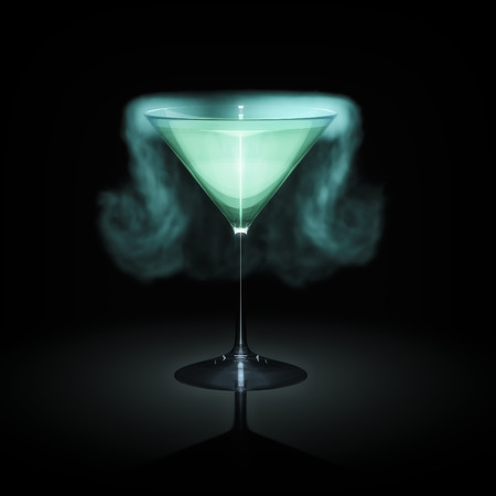 liquor glass: A blue smoking cocktail glass in front of a black background Stock Photo
