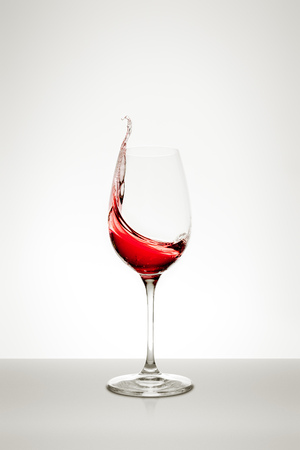 red swirls: red wine splashing out of the glass