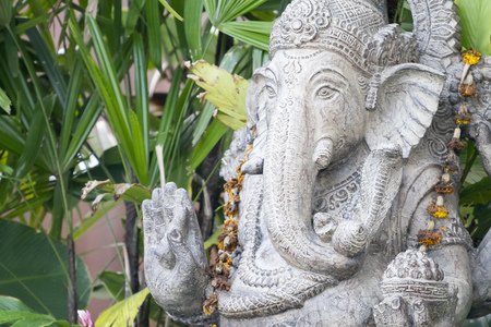 indian head: An image of a ganesha sculpture in the garden Stock Photo