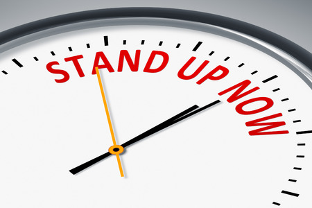 stand up: An image of a typical clock with text Stand up now Stock Photo