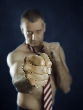 An image of a naked business man fighting photo
