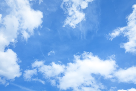 bright sky: An image of a bright blue sky with some clouds