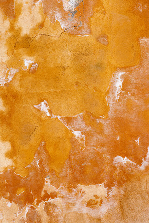 antique background: An image of an orange grunge wall background Stock Photo