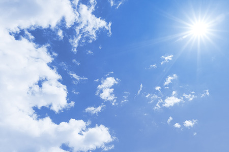 A blue sky with sun and clouds background Stock Photo