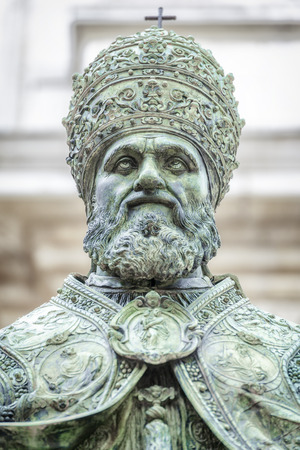pontiff: An image of a statue of Pope Sixtus V in front of the Basilica della Santa Casa in Italy Marche Stock Photo