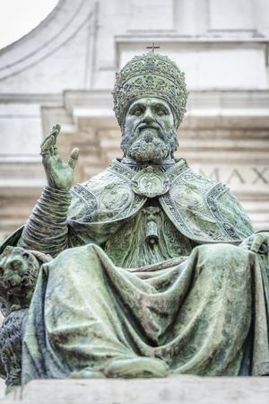 pontiff: An image of a statue of Pope Sixtus V in front of the Basilica della Santa Casa in Italy Marche Stock Photo