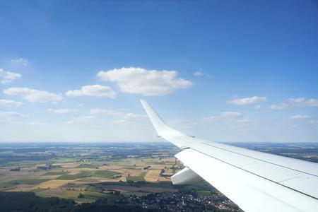 thru: An image of a view thru an airplane window