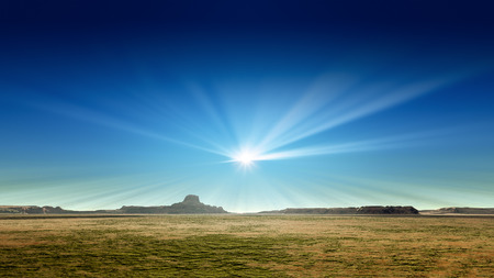 monument valley: 3d rendering of a desert scenery with sun rays in the blue sky