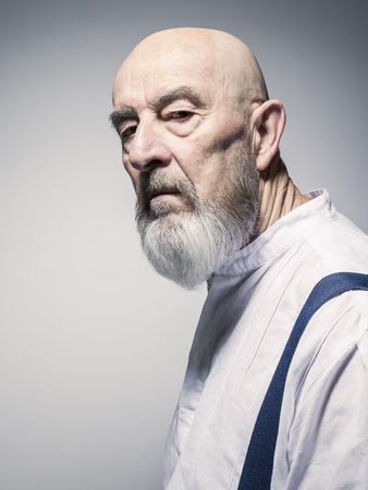 shadow man: An image of a strange looking older man portrait