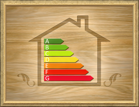 heating engineers: An image of a wooden house with energy efficiency graph Stock Photo