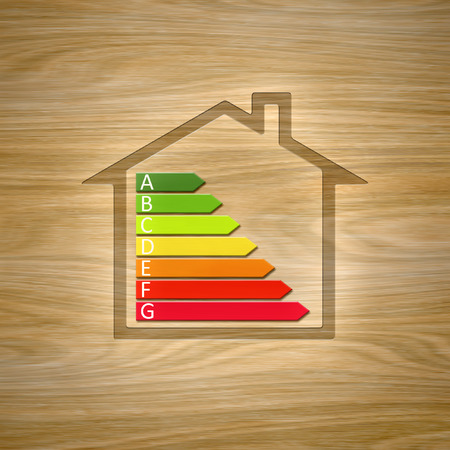 An image of a wooden house with energy efficiency graph Stock Photo