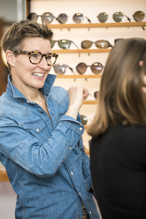 An image of a friendly service at the optometry glasses shop photo