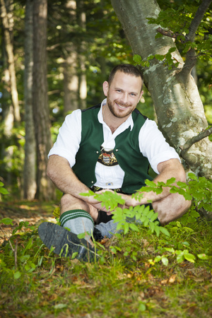 lederhosen: An image of a bavarian traditional man in the forest