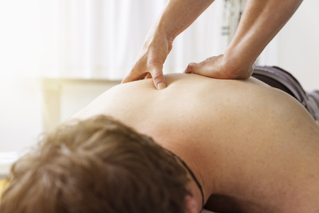An image of a young man at the physio therapy Stock Photo