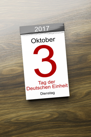 3D-weergave van een kalender de 3e van oktober Dag van de Duitse eenheid tekst in de Duitse taal Stockfoto