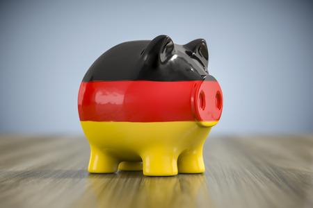 3d illustration of a fat piggy bank in german colors Imagens