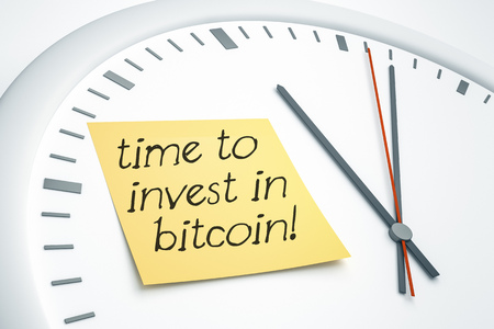 3D illustration of a bright clock with a sticky note and the message time to invest in bitcoin