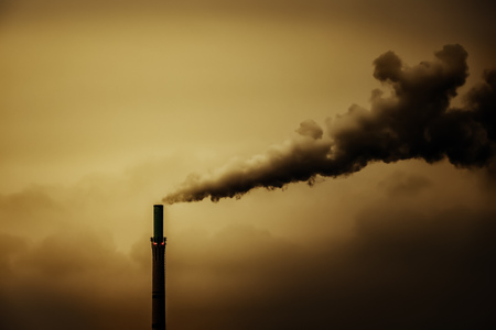 An image of an industrial air pollution smoke chimney Stock Photo