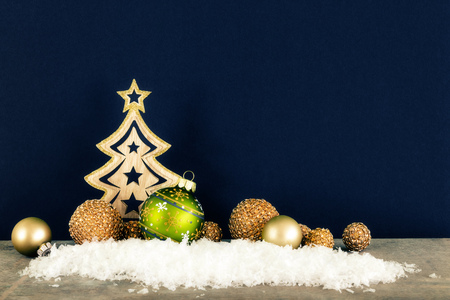 Christmas decoration dark background with wooden tree glass balls and snow Stock Photo