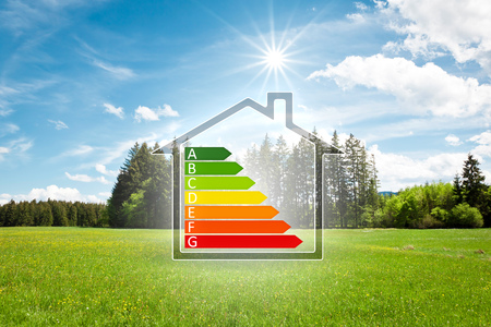 An image of a house in the green with energy efficiency graph Stock fotó