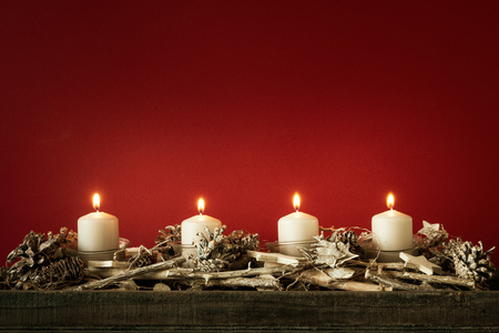 Advent time four candles burning with red
