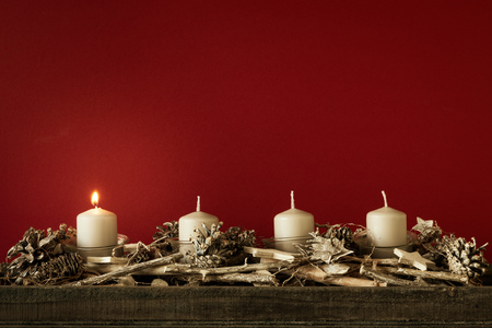 Advent time one candles burning with red