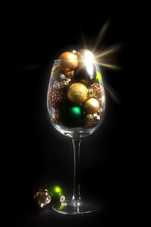 A Christmas Decoration Wine Glass On Black With Glass Balls