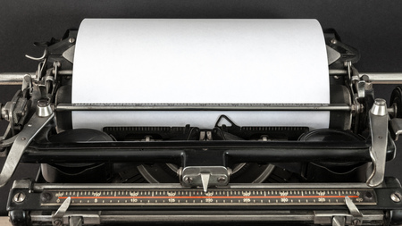 Vintage typewriter header with blank sheet of white paper retro technology top view Stockfoto