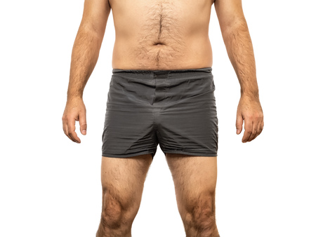 An image of a middle age male torso grey pants