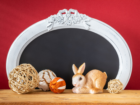 An image of an Easter decoration rabbit and vintage frame