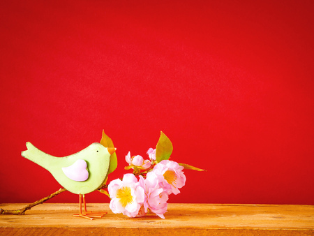 An image of a bird with a branch of blossoms easter holiday decoration background Imagens