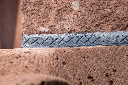 An image of a fugue of lead in red sandstone
