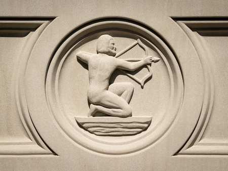 An image of a Zodiac Sagittarius sign in stone