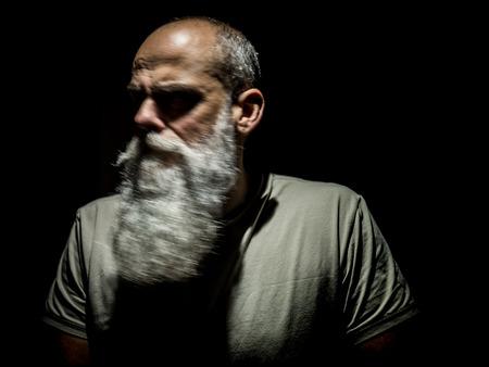 An image of a bearded man motion blur portrait