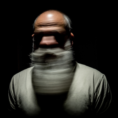 An image of a bearded man motion blur portrait Archivio Fotografico