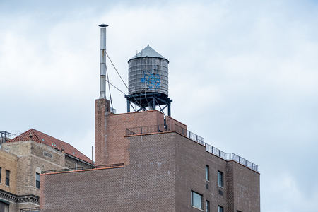 A typical water tank on the roof of a building in New York City