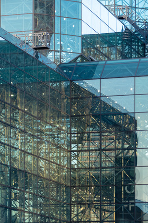 An image of a modern glass building construction in New York City USA