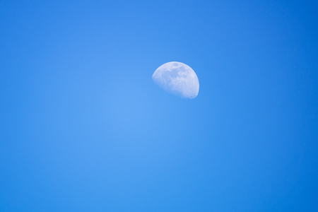 An image of a moon at day time sky background