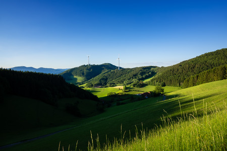 An image of a landscape with wind energy in the black forest area Germany Standard-Bild - 124797942