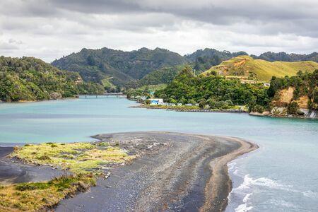 An image of sea shore rocks and mount Taranaki, New Zealand Stockfoto