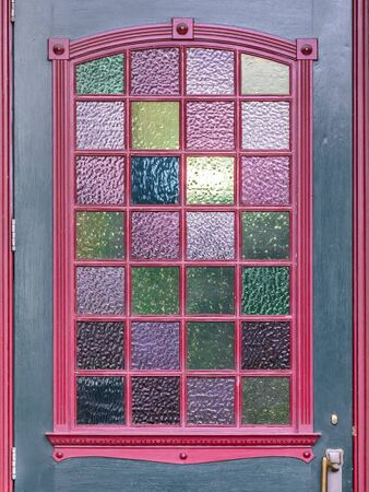An image of a colorful door window