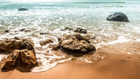 An image of the boulders at the beach of Moeraki New Zealand