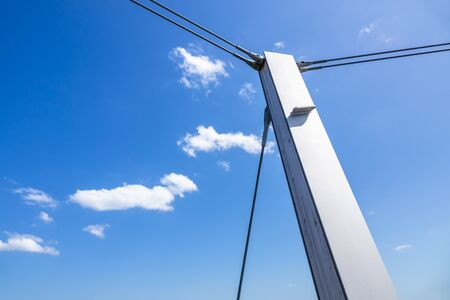 An image of a pole in front of a blue sky Banco de Imagens