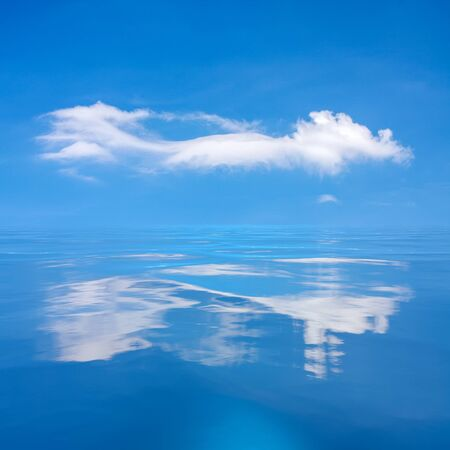 An image of the blue sky with white cloud over the sea
