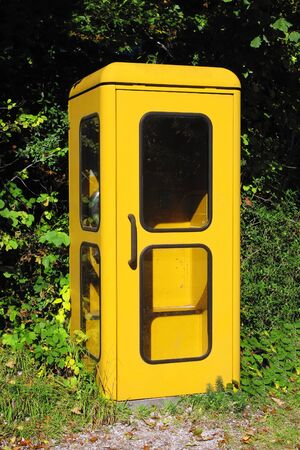 An image of a vintage yellow german phone box