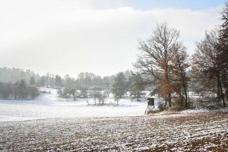 A photography of a snowscape with hunter stand Banque d'images - 130128304