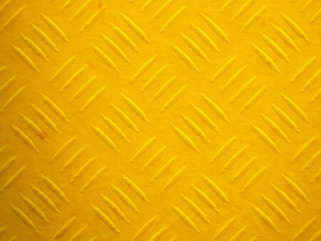 Illustration of a yellow painted diamond metal plate texture